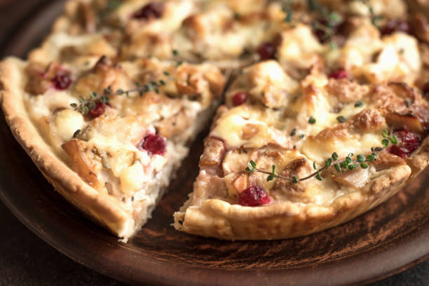 Turkey or Chicken leftover Tart Pie Turkey or Chicken leftover Tart Pie with pears, cheese and cranberries. Thanksgiving or Christmas turkey leftovers homemade quiche, copy space, top view. leftovers stock pictures, royalty-free photos & images