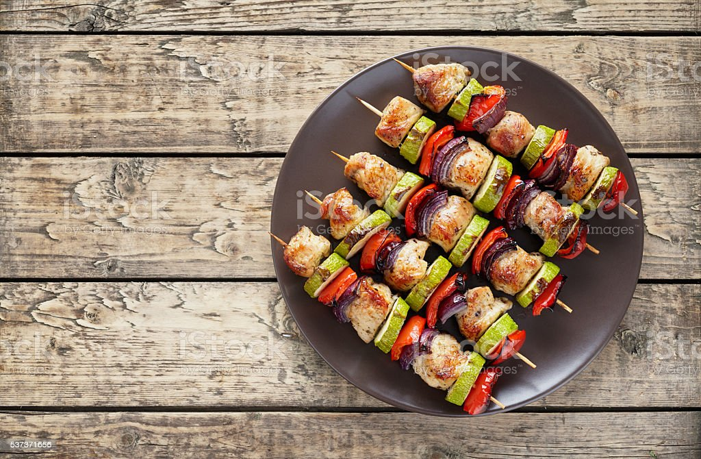 Turkey or chicken shish kebab skewers with pepper tomatoes stock photo