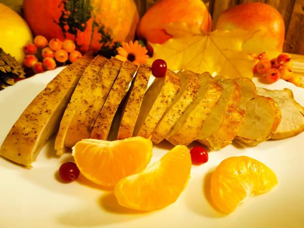 turkey, pieces of thanksgiving day maple leaf canada, still life, dish, menu, slice, tangerine - pumpkin pie стоковые фото и изображения