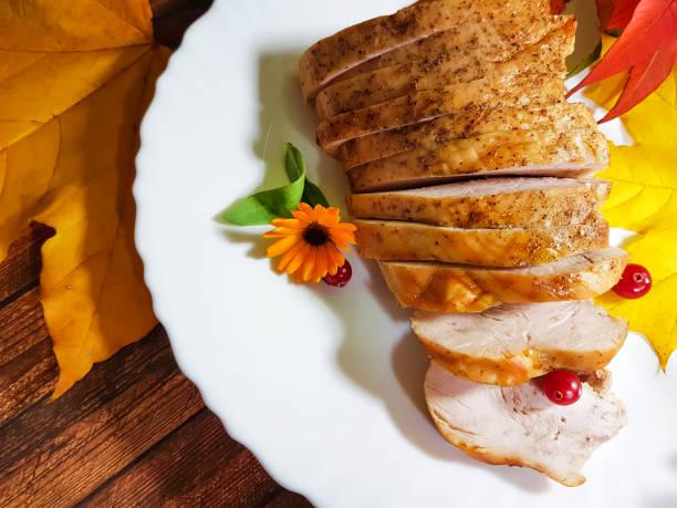 turkey pieces of thanksgiving day maple leaf canada, still life, flower - pumpkin pie стоковые фото и изображения
