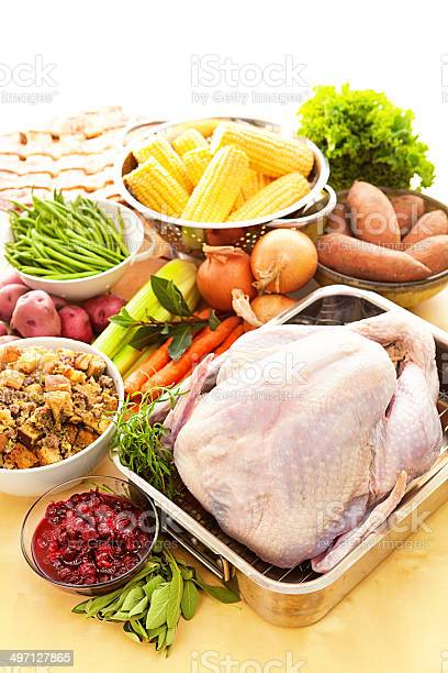 Turkey Raw Ingredients For Thanksgiving Dinner Preparation Vertical Stock Photo - Download Image Now
