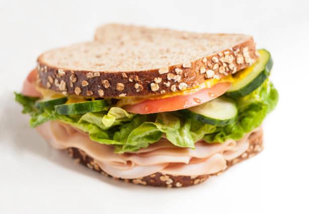 turkey sandwich isolated - panino ripieno foto e immagini stock