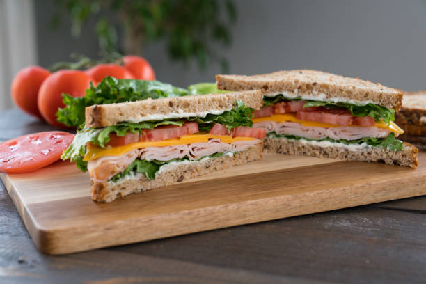 Turkey Sandwich on a Cutting Board stock photo