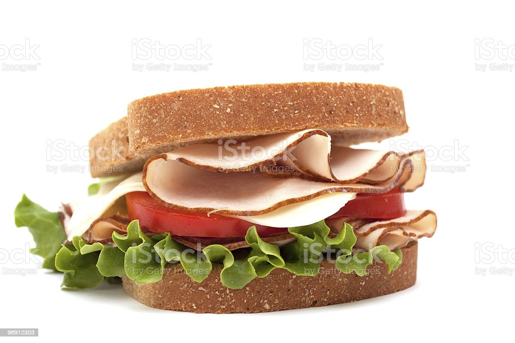Turkey sandwich on wheat bread royalty-free stock photo