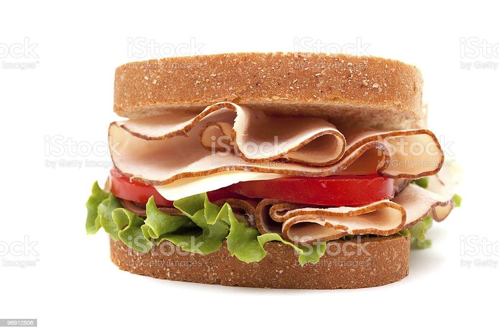 Turkey sandwich on wheat bread royalty-free stock photo