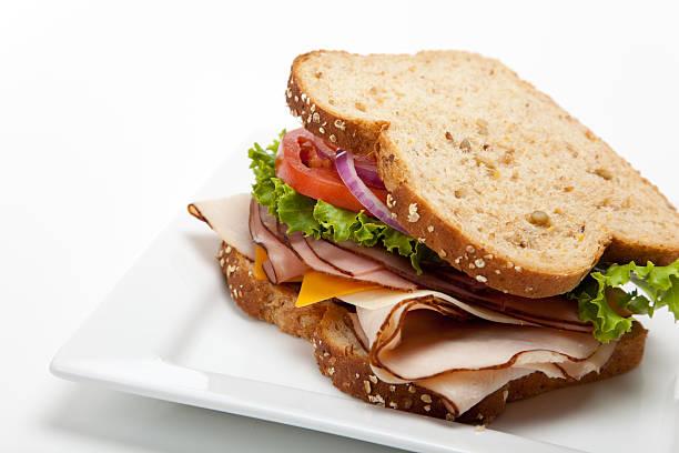sandwich di tacchino su sfondo bianco - panino ripieno foto e immagini stock