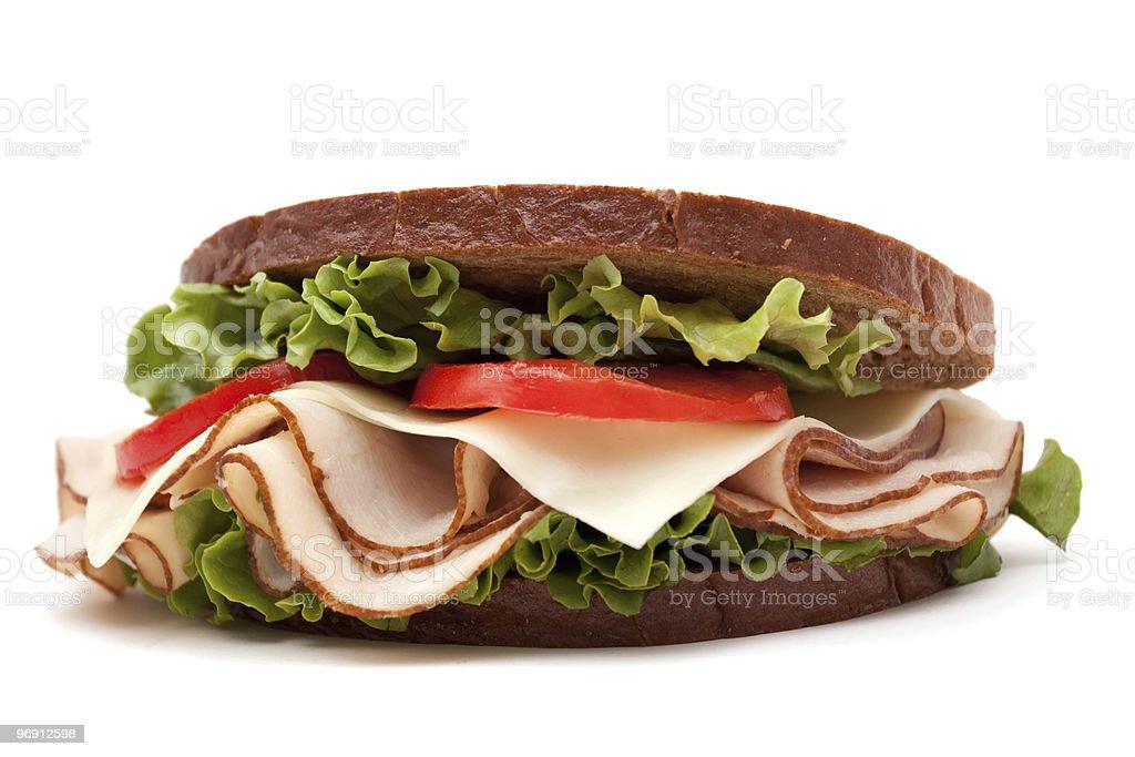 Turkey sandwich on white background royalty-free stock photo