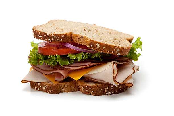 turkey sandwich on whole-grain bread - sandwich stockfoto's en -beelden