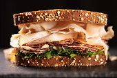 Turkey sandwich with lettuce and bacon