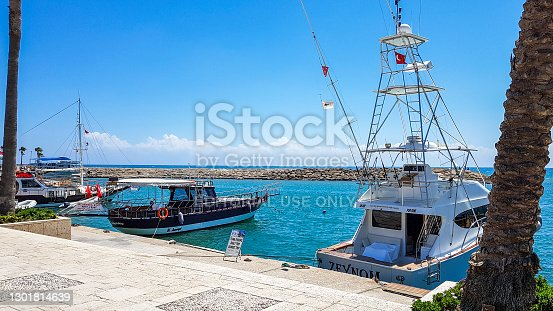 Side, Antalya, TURKEY - June 30 2018: Turkey Side neighborhood who have also connected to the port of Antalya province, private yachts, commercial vessels, fishing boats and people browsing