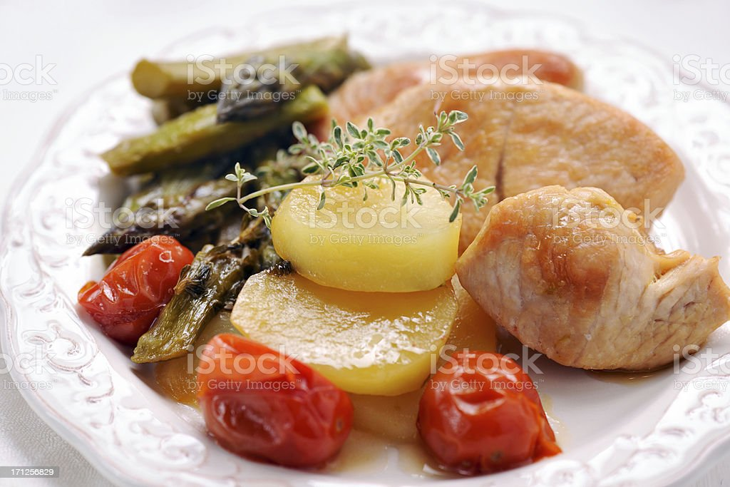 Turkey steak with potatoes,asparagus and tomato royalty-free stock photo