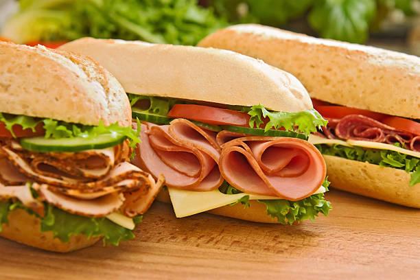 turchia/petto di pollo, prosciutto e salame panini & svizzera - panino ripieno foto e immagini stock