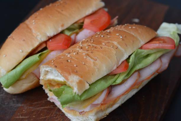 Turkey/chicken breast, ham & swiss and salami sandwiches Sandwich, Submarine Sandwich, Baguette, Ham, Lunch submarine sandwich stock pictures, royalty-free photos & images
