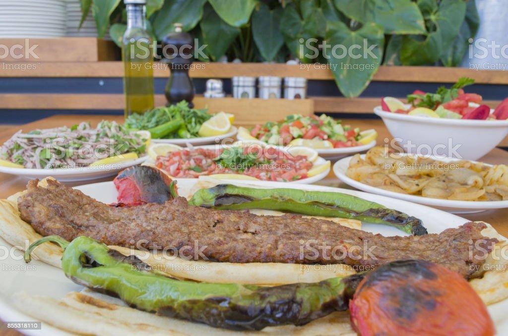 Turkish adana kebab and salads menu stock photo