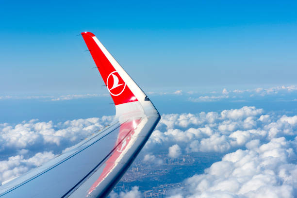 THY, Turkish Airlines airplane wing over the clouds stock photo