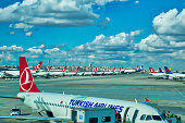 Istanbul, Turkey-October 10, 2017: Turkish Airlines planes waiting for passengers on the tarmac near renovated airport terminal