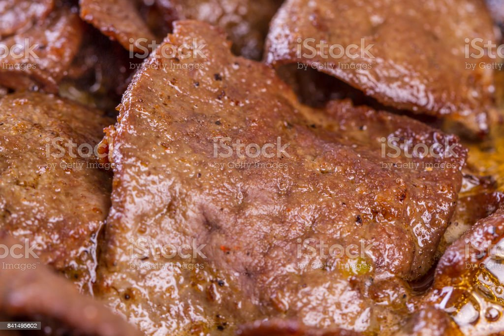 Turkish and Arabic Traditional Ramadan Food Lamb Kavurma Guvec with hot red pepper on top. Top view on white rustic wood background. stock photo