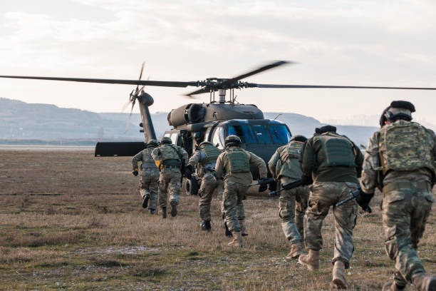 Turkish Army soldiers boarding military helicopter Ankara, Turkey - May 16, 2017: Turkish Gendarmerie exercise and demonstration in a field near Ankara  in Turkey.Turkish Gendarmerie soldiers boarding a Sikorsky UH-60 Black Hawk military helicopter while some other soldiers providing covering fire. battlefield stock pictures, royalty-free photos & images