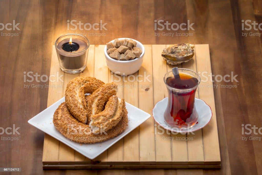 Turkish bagel, simit with Turkish tea on wood table