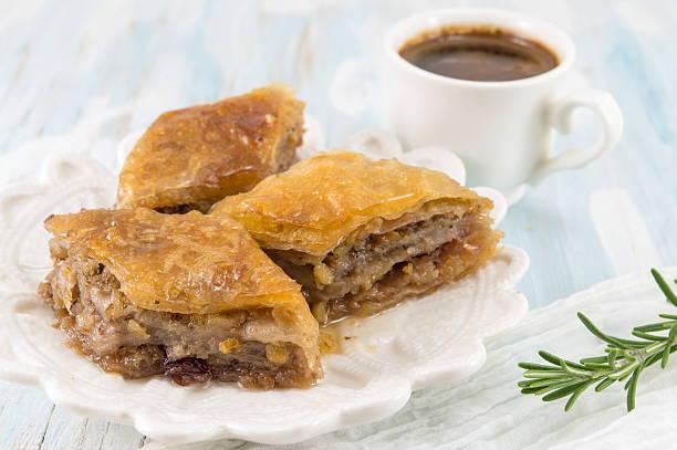 Turkish baklava dessert and coffee on a plate - Photo