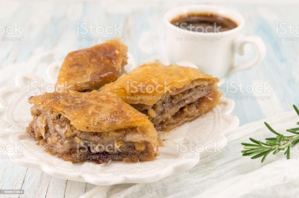 Turkish baklava dessert and coffee on a white plate