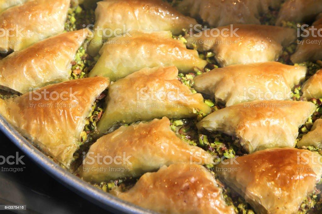 Turkish baklava sobiyet with pistachio nuts. stock photo