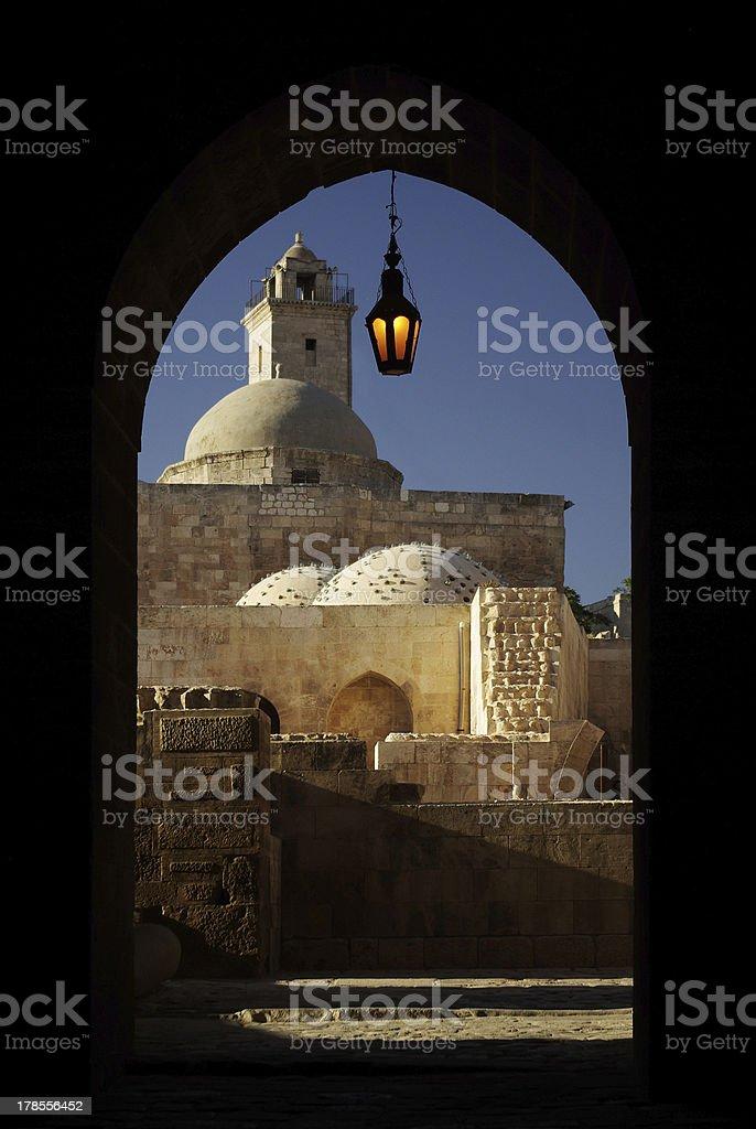 Turkish bath and minaret in citadel of Aleppo, Syria stock photo