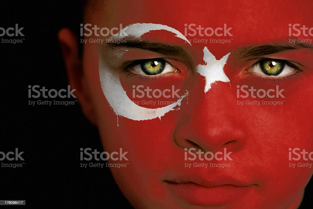 Turkish boy with the flag of Turkey royalty-free stock photo