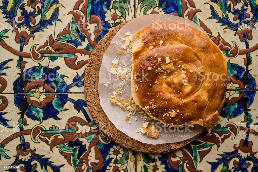 Turkish Bread Kete on a Ottoman Pattern surface. stock photo