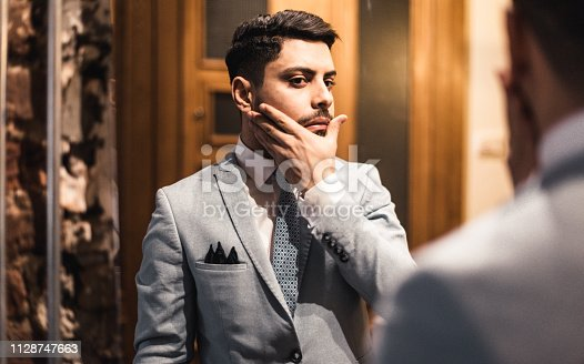 istock turkish business man in front of the mirror 1128747663