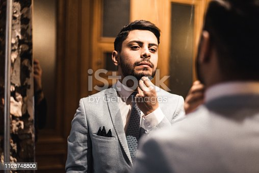 istock turkish business man in front of the mirror 1128748800