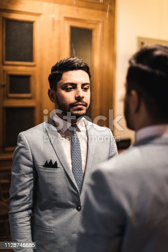 istock turkish business man in front of the mirror 1128748885