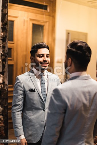 istock turkish business man in front of the mirror 1128749078