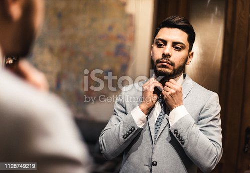 istock turkish business man in front of the mirror 1128749219