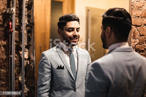 istock turkish business man in front of the mirror 1128749314