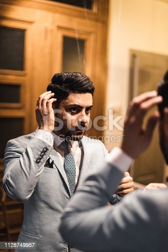istock turkish business man in front of the mirror 1128749957