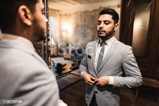 istock turkish business man in front of the mirror 1128750198