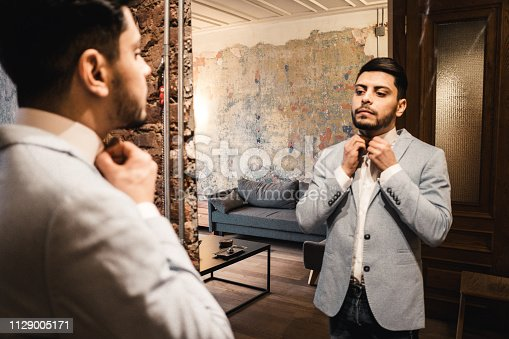 istock turkish business man in front of the mirror 1129005171