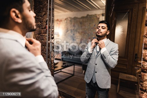 478838034 istock photo turkish business man in front of the mirror 1129005273