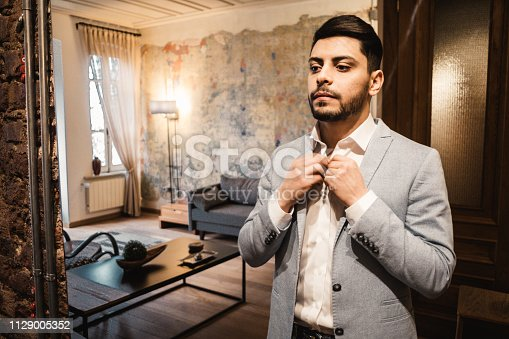 istock turkish business man in front of the mirror 1129005352