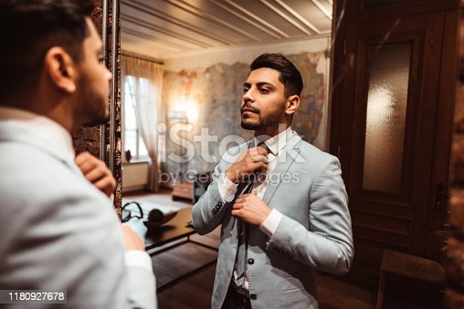 478838034 istock photo turkish business man in front of the mirror 1180927678