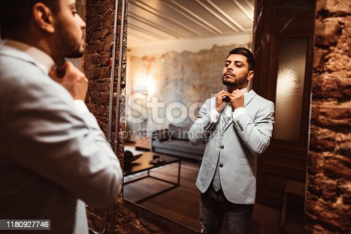 478838034 istock photo turkish business man in front of the mirror 1180927746