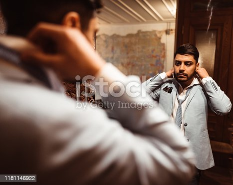 478838034 istock photo turkish business man in front of the mirror 1181146922