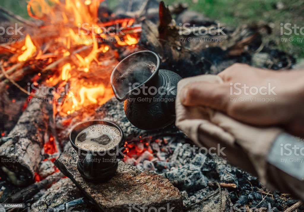 Turkish coffee making process on campfire stock photo