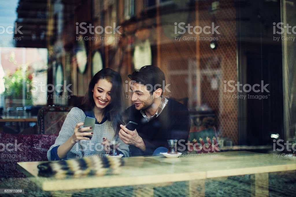 Turkish Couple in Cafe Use Smart Phones stock photo