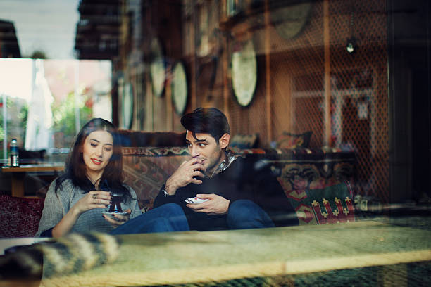 Turkish Couple in Cafe Use Tablet stock photo