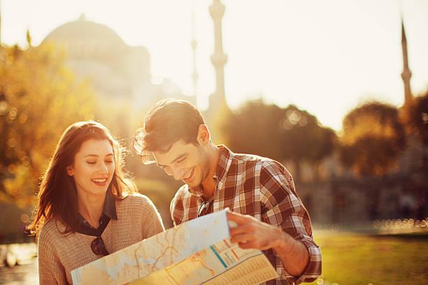 Turkish Couple Use Paper Map stock photo