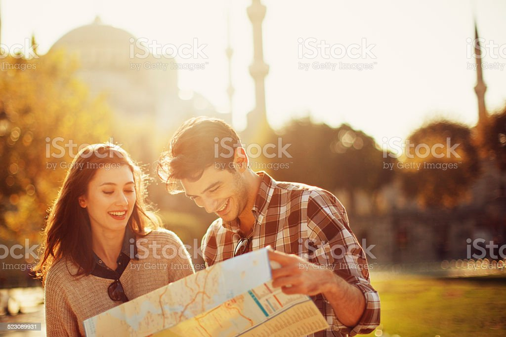 Turkish Couple Use Paper Map stock photo