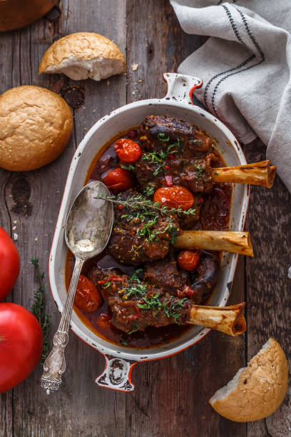 Turkish cuisine braised lamb in tomato sauce with spices and herbs stock photo