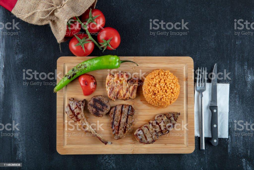 Turkish cuisine, Mixed Grill on wooden serving plate; Steak, steak,...